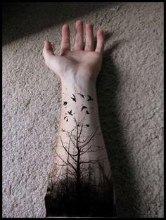 Black tree tattoo design for men on arm