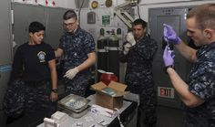 EVERETT, Wash. (Feb. 5, 2014) Hospital corpsmen on board the aircraft carrier USS Nimitz (CVN 68) provide vaccinations for Sailors. Nimitz recently returned to its homeport of Naval Station Everett after a nine-month deployment. (U.S. Navy photo by Mass Communication Specialist 3rd Class Derek W. Volland/Released)