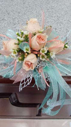 peach and mint prom corsage from  Gallery Florist and Gifts in Mebane, NC.  www.galleryfloristandgifts.com