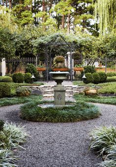 The bushy Liriope around the center fountain serves as a gentle boundary/border protecting a delicate fountain or sculpture. Boxwood Garden, Garden Urns, Garden Fountains, Garden Paths, Outdoor Landscaping, Front Yard Landscaping, Outdoor Gardens, Amazing Gardens, Beautiful Gardens
