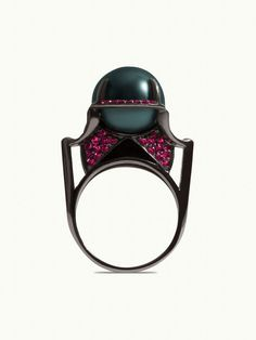 The Isis ring features a mystical Tahitian black pearl, enthroned in an black gold setting bejeweled in pavé set green tsavorite garnet gemstones and detailed with hand-painted black enamel. As seen worn by Beyoncé and actress Gillian Anderson. Black Gold Jewelry, Black Rings, Yellow Gold Rings, Tahitian Pearl Ring, Tahitian Black Pearls, Isis Goddess, Egyptian Goddess, Platinum Jewelry, Gold Set