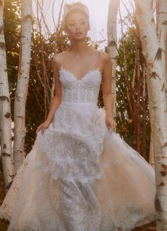 A-line lace wedding dress with sweetheart neckline, corset bodice and spaghetti straps | Feminine chic boho bridal gown | 6 Best Places to Buy Wedding Dresses and Jewelry - Belle The Magazine | See more gorgeous bridal gowns by clicking on the photo