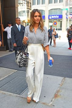 Jessica Alba gets 70's dressing right. Note the platforms, please. Photo: Josiah Kamau / Getty Images