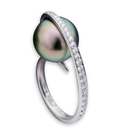 * Etienne Perret Madonna fashion ring with a Tahitian pearl embraced in platinum, accentuated by pave-set gvs diamon