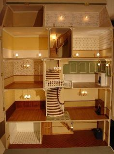 Dolls house - Brick Georgian Townhouse pic (lovely interior - like the staircase and how it narrows leading up to the servants quarters): DIY projects are not only tons of fun; they are also beneficial to you and your family! Doll House Plans, My Doll House, Miniature Rooms, Miniature Houses, Dollhouse Dolls, Dollhouse Miniatures, Cardboard Dollhouse, Victorian Dollhouse, Dollhouse Ideas