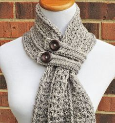 The Hartford Buttoned Scarf is a beautiful, lacy scarf featuring a unique construction, extra-long fringe and two trendy button bands to keep it snug and [. Col Crochet, Crochet Shawl, Crochet Stitches, Free Crochet, Crochet Buttons, Crochet Granny, Crochet Yarn, Hand Crochet, Loom Knitting