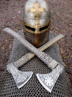 Two ancient axes and a helm discovered in Orgrirholmic ruins. Runes indicate that these belonged to the demigod Aldvif Gaedison. Swords And Daggers, Knives And Swords, Espada Viking, Arte Ninja, Viking Axe, Viking Sword, Viking Helmet, Battle Axe, Medieval Weapons