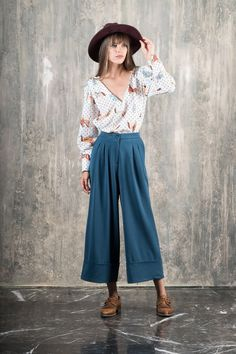 Love the contrast of the deep, feminine V-neck line and the girly horse pattern uniquely designed for Karavan Clothing. The puff sleeves and big cuffs give a st