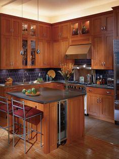 Shaker cabinets with wood floor, grey countertops, and tile backsplash