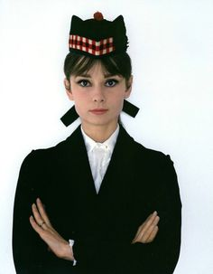 Audrey is dressed in a traditional Scottish cap, the Glengarry is a boat-shaped cap without a peak made of thick wool with a bobble on top and ribbons in the back, photo by Howell Conant, 1961