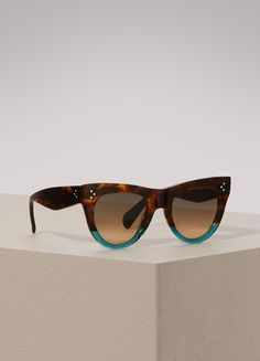 2bf4f6023aa0 Céline worked a lot of sophistication into these cat eye sunglasses. The  Havana brown of