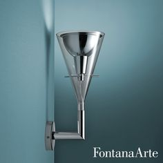 With transparent borosilicate glass body, FontanaArte Flute Wall Lamp has reflector in polished chromed aluminium. #FontanaArte #walllamp #FrancoRaggi Available at allmodernoutlet.com  http://www.allmodernoutlet.com/fontanaarte-flute-wall-lamp/