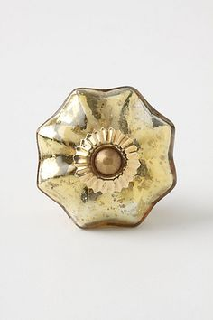 fancy mercury glass melon knob in gold, Anthropologie $8 each - OR plain old knobs in the laundry room?  there are other crystal/glass/porcelain options too...