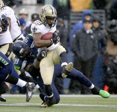 New Orleans Saints running back Khiry Robinson, right, is tackled by Seattle Seahawks defensive tackle Tony McDaniel during the first half of an NFC divisional playoff NFL football game in Seattle, Saturday, Jan. 11, 2014. (AP Photo/John Froschauer)