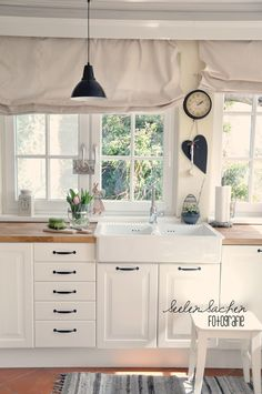 Love white kitchens! I just painted my cabinets white...thanks to pinterest lol