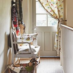 Country hallway with bird print fabrics and natural flooring