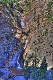 Seven Falls, Colorado Springs. Seven Falls is a series of seven cascading waterfalls of South Cheyenne Creek in South Cheyenne Canyon, Colorado. The falls are named from top to bottom: Ramona, Feather, Bridal Veil, Shorty, Hull, Weimer and Hill.