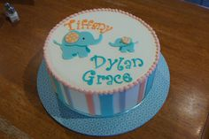 Blue elephants and stripes baby shower cake