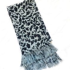 Snow leopard scarf Super warm A tad bit fuzzy but not very much (picture provided)  Length with fringe: 61 inches Width: 7.5  Top 10% Seller  Fast Shipper  No trades or Paypal (Posh Etiquette #8)  Not a smoker :)  Bundle Pricing: 2 for 20% off Accessories Scarves & Wraps