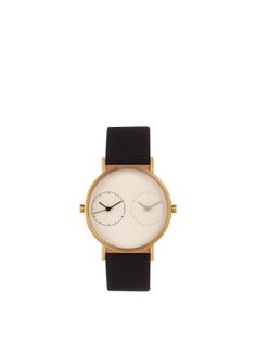Simple geometric form meets modern materials in Kitmen Keung's brushed gold-tone 316L stainless-steel Long Distance 1.0 watch. It comes with a black Argentinian calf-leather strap and has a round white face with one black and one grey dial. It used two quartz 3-hand Japanese hand movement and is has 5ATM water resistance.