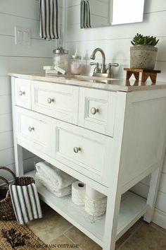 ... finishing ideas open bathroom vanity with baskets on shelf for storage