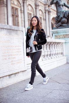 black motorcycle jacket + grey sweater + black leather leggings + snakeskin sneakers