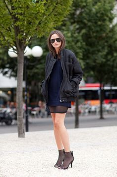 Columbine Smille embraces all things mesh in an Isabel Marant dress and Dolce & Gabbana heels — paired with a Carin Wester bomber and Whyred sweater dress — Stockholm Fashion Week Spring 2013