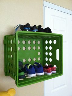 SHOE SHELF: plastic crate and some push pins :) Shoe piles on the floor are so messy and if you have a baby, the pile doesn't last long. Put the shelf up high enough to where only Mom can reach the shoes.