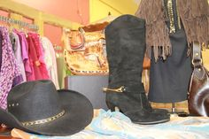Boots with Spurs and a cowgirl hat for are the perfect Calgary Stampede Accessory.
