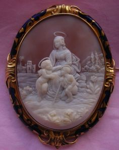 Madonna of Foligno from a Raffaellos painting Sardonyx Shell Cameo in 18k Gold and Blue Enamel, Italy, c 1850-1860 Frame is English