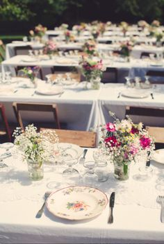 love the floral arrangement and wooden chairs x