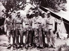 """Waffen SS Soldiers of the 16th SS Division """"Reichsfuhrer SS"""" pose in tropical gear somewhere earlier inCorsica. . This is the official tropical uniforms of the Waffen SS. It consisted of an Italian cut Sahariana Jacket and baggy pants in tan tropical cloth. A tropical m43 hat was also worn without the false ear flaps. The insignia was embroidered in golden cotton thread on a black background."""