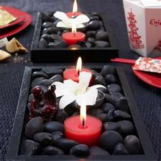 trays, rocks, and tealights---cute for an outdoor patio table centerpiece