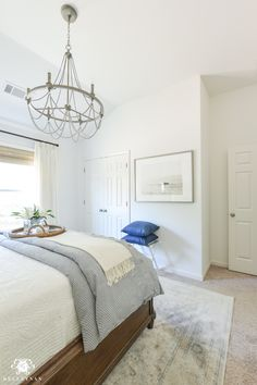 One Room Challenge Blue and White Guest Bedroom Reveal Before and After Makeover guest bedroom with chandelier from vaulted ceiling