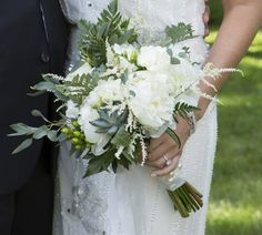 """Natural Green wedding Bouquet Looking for that """"Just picked from the garden"""" look - you've found it. Lush peonies and succulents nestle between freesia, astilbe, hypericum berries and assorted greens in this unstructured bouquet. Available with ivory or cream double-faced satin or burlap wrap and pearl or crystal pins. Measures approx. 16"""" diameter by 14"""" tall. - wedding flowers"""