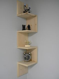 Wall mounted hand made retro corner shelf even use the corners. Stace, I bet you could do this!