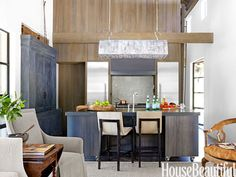 """In a natural and modern Sonoma house, the steel island is topped with Pietra Grigia granite set into a metal frame. Barstools by Holly Hunt. Custom light fixture. A recessed oak cabinet was wire-brushed and stained black to echo the gunmetal finish on the island. """"I like to use black in all my interiors,"""" says designer Rela Gleason. """"It's like an exclamation point."""" sonoma hous, steel kitchen, kitchen colors, hous beauti, kitchen open, modern houses"""