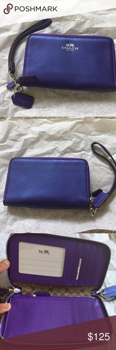 NWT Iridescent purple Coach wristlet 2 zippered areas. 1 holds 10 card slots & the other fits an iPhone 6 (or can be used to hold extra cards/coins). Coach Bags Clutches & Wristlets