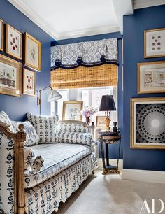 Painted a Benjamin Moore blue, the guest room features a Louis XVI daybed upholstered in a Les Indiennes fabric | archdigest.com