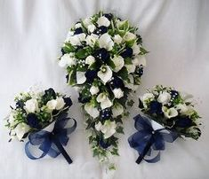 Brides Bouquet with 2 Bridesmaids Posies with cala lilies and Ivory and Navy Blue Roses. This set has been made using artificial cala lilies, ivory and navy blue roses with a selection of foliage. Inexpensive Wedding Flowers, Navy Wedding Flowers, Navy Blue Flowers, Bridal Flowers, Flower Bouquet Wedding, Blue Roses, Artificial Wedding Flowers, Blue Orchids, White Flowers