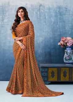 Yellow Color Printed Georgette Saree Product Details : Fabric of this casual wear saree is georgette. Comes along with a yellow color raw silk unstitched blouse. Saree has flower design print. Ideal for casual wear or daily wear. Drape this party w Latest Designer Sarees, Latest Sarees, Saree Sale, Grey Saree, Celebrity Gowns, Sari Dress, Trendy Sarees, Casual Saree, Buy Sarees Online
