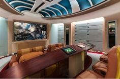 "The 27,000-square-foot home, with eight bedrooms and 16 bathrooms has a theater that looks like an exact replica of the bridge of the Star Trek Enterprise. The theater comes complete with original series sound effects for the doors and hundreds of thousands of stars built into the ceiling. There is also a ""Call of Duty"" room modeled after the video game, a half-size college football field, and a ballroom with more than 60 arcade games that date back to the 1970s."