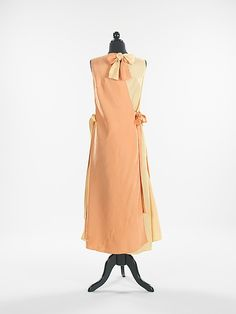 Elsa Schiaparelli beachwear dress and jacket silk made in summer 1930. A creative example from Schiaparelli's early career and exemplary of her talent for sports clothes, this beach or resort ensembles would have been worn while vacationing at one of the many fashionable seaside resorts. This inventive and original Schiaparelli design allows for numerous variations, as the dress is two halves that tie together to make a whole and the jacket is reversible.