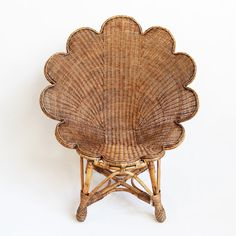 Hand woven rattan shell shaped occasional chair with antiqued stained finish.