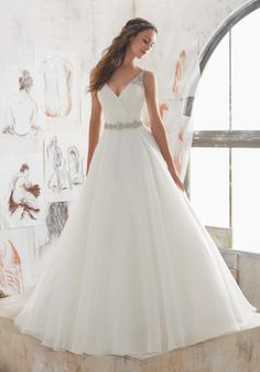 e6454f4681d3 Designer Wedding Dresses and Bridal Gowns by Morilee. This Organza Wedding  Ballgown Combines a Traditional