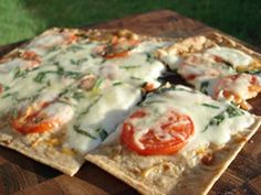Using a nice whole wheat lavash bread and a few other simple ingredients, you can easily create your own light and crispy pizza.