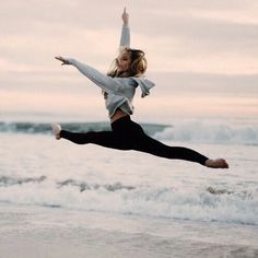 doing splits in the beach