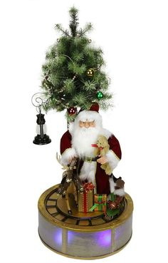 Asstd National Brand 4' Animated and Musical Lighted LED Santa Claus with Tree and Rotating Train Christmas Decor