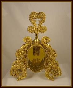 A perfume bottle from the estate of a Las Vegas showgirl. This fabulous perfume bottle was a gift from one of her admirers. Standing a stately 9 tall and is wide at the