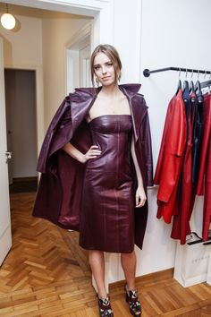 Maroon strapless leather dress and matching leather jacket